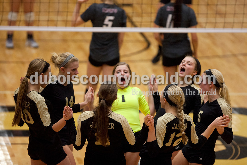 Erica Lafser/The Herald<br /> Jasper's volleyball team shared a moment before a set during Saturday's Class 3A semistate match against Northview at Jasper High School. The Wildcats' lost in four sets.