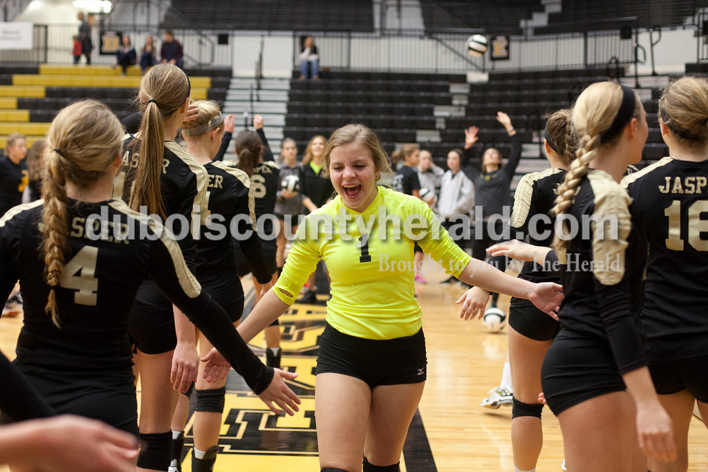 Erica Lafser/The Herald<br /> Jasper's Layne Sermersheim pumped up her teammates during warmups before Saturday's Class 3A semistate match against Northview at Jasper High School. The Wildcats' lost in four sets.