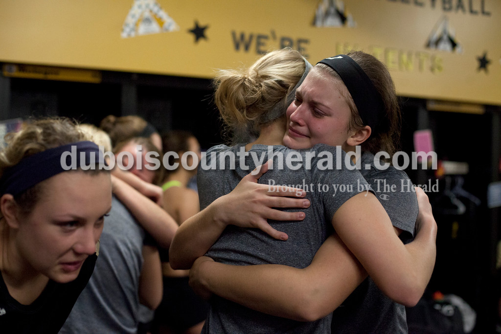 Erica Lafser/The Herald<br /> Jasper's Maddie Edwards hugged teammate Teyah Leinenbach after Saturday's Class 3A semistate match against Northview at Jasper High School. The Wildcats' lost in four sets.