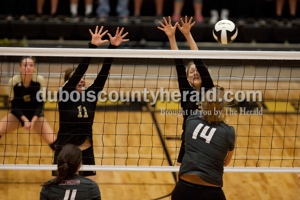 Erica Lafser/The Herald<br /> Jasper's Jocelynn Morrow, left, and Libby Bell defended the net during Saturday's Class 3A semistate match against Northview at Jasper High School. The Wildcats' lost in four sets.