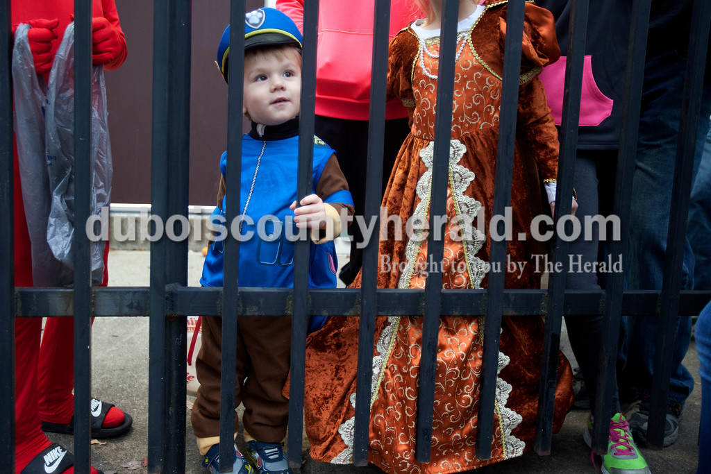 Erica Lafser/The Herald<br /> Cody Blackgrove of Huntingburg, 2, dressed as Paw Patrol Chase, waited in line for the trick-or-trail event on Saturday hosted by the Huntingburg United Methodist Church at League Stadium in Huntingburg. The trail had several booths for children to receive candy or trinkets.
