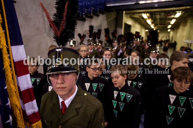 Alisha Jucevic/The Herald <br /> Forest Park junior Jaxon Welf let the band onto the field during the ISSMA State Marching Band competition awards on Saturday at Lucas Oil Stadium in Indianapolis. The Marching Rangers won their fourth straight ISSMA Open Class D state championship.