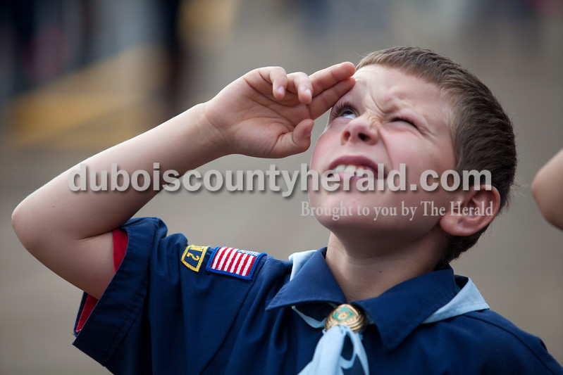 Alisha Jucevic/The Herald <br /> Pine Ridge Elementary school fourth-grader Seth Striegel saluted the flag during the playing of taps at a Veterans Day program at Pine Ridge Elementary School on Friday morning in Birdseye. To honor the veterans, the students also read poems, sang and recited the Pledge of Allegiance during the event.