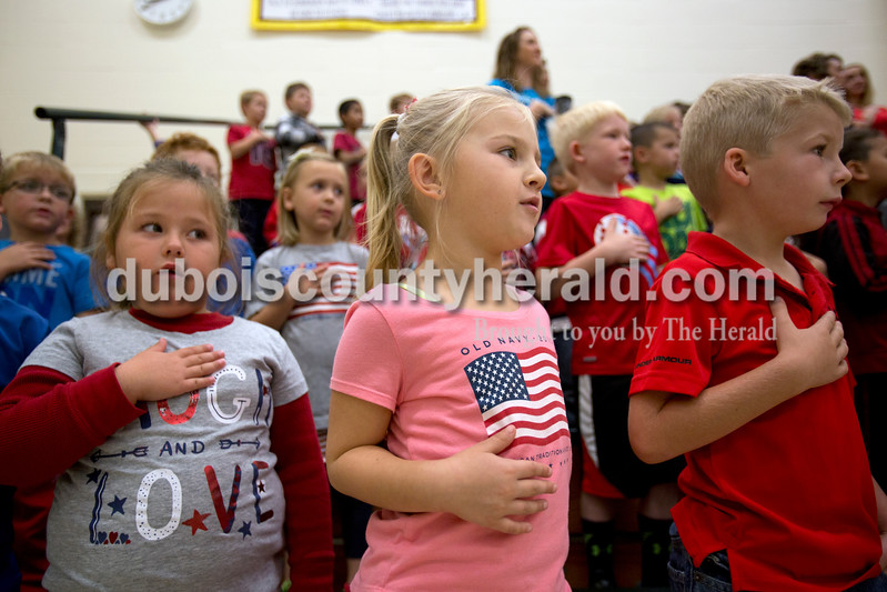 Alisha Jucevic/The Herald <br /> Pine Ridge Elementary School pre-schoolers Madison Fettes, Adison Andry and Austin Vonderheide decided the Pledge of Allegiance during a Veterans Day program at Pine Ridge Elementary School on Friday morning in Birdseye.
