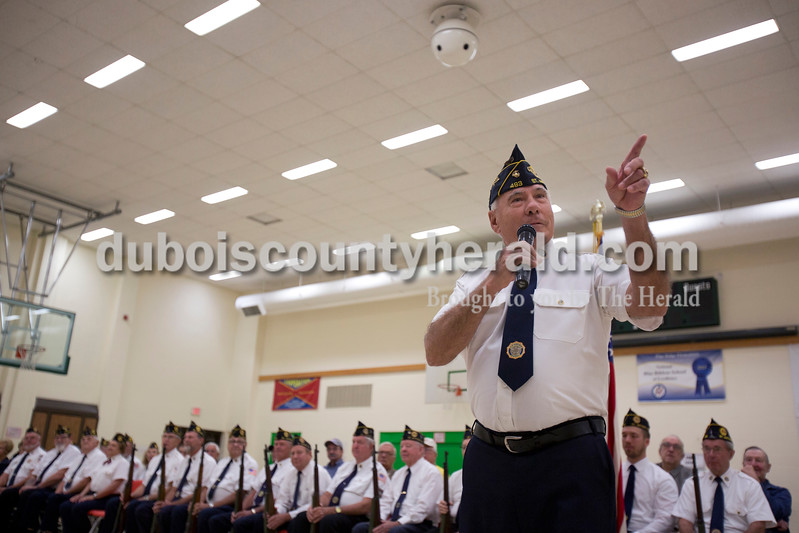 Alisha Jucevic/The Herald <br /> Birnie Jeffries of St. Anthony spoke during a Veterans Day program at Pine Ridge Elementary School on Friday morning in Birdseye. Members of St. Anthony's American Legion post 493 and veterans who have relatives at the elementary school attended the event.