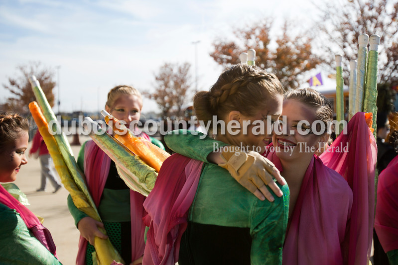Alisha Jucevic/The Herald <br /> Jasper color hard members Lindsey Aders, sophomore, and Chloe Daum, freshman, embraced as they waited to enter Lucas Oil Stadium for the ISSMA State Marching Band competition on Saturday in Indianapolis. The Marching Wildcats placed fourth in ISSMA Open Class B.