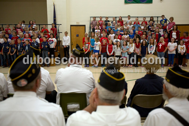 Alisha Jucevic/The Herald <br /> Students and teachers at Pine Ridge elementary school during a Veterans Day program at Pine Ridge Elementary School on Friday morning in Birdseye. To honor the veterans, the students read poems, sang and recited the Pledge of Allegiance during the event.