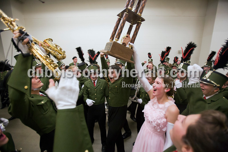Alisha Jucevic/The Herald <br /> Forest Park drum major Alyssa Hurm, senior, and Luke Steffe, senior, held the first place trophy as the band left Lucas Oil Stadium on Saturday at the ISSMA State Marching Band competition in Indianapolis. The Marching Rangers won their fourth straight ISSMA Open Class D state championship.