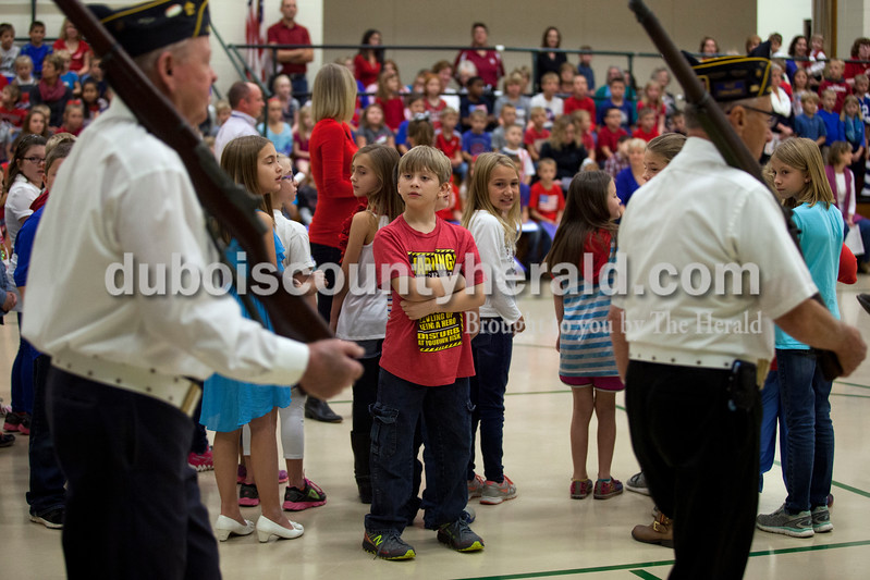 Alisha Jucevic/The Herald <br /> Pine Ridge Elementary school fourth-grader Aiden Gilpatrick watched members of St. Anthony's American Legion post 493 as they walked into the gymnasium during a Veterans Day program at the elementary school on Friday morning in Birdseye. The event is held every year to honor the veterans and allow the students to learn more about the veteran's who live in their community.