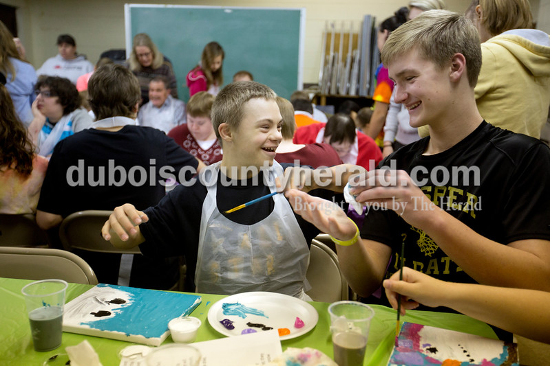 Ariana van den Akker/The Herald<br /> Adam Nordhoff, 12, left, joked around with his buddy Jadon Mehringer, 15, both of Jasper, during a painting class for kids and adults with special needs hosted by the Jasper Optimist Club at the Jasper Arts Center's satellite space. Each participant had a buddy to help as much as needed during the class.