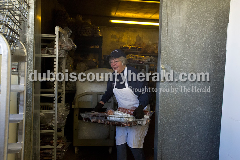 Erica Lafser/The Herald<br /> Margaret Sander of Celestine carried out a customer's order from the freezer to bag and give to them on Thursday at Sander Processing in Celestine.