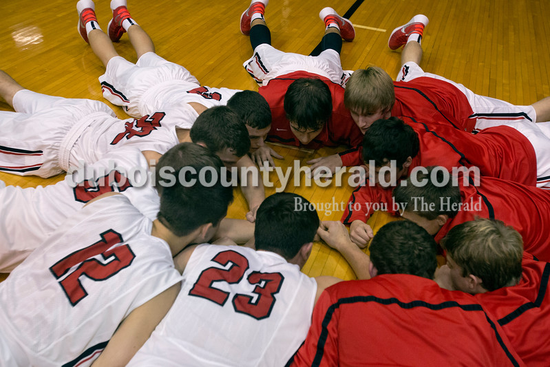 Erica Lafser/The Herald<br /> Southridge's boys basketball team gathered on the floor before Saturday night's game against Corydon Central at Memorial Gym in Huntingburg. The Raiders won 54-39.