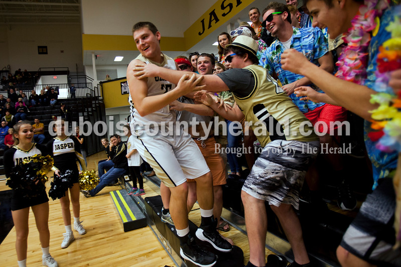 Jasper's Justin Goebel jumped back onto the court after falling into the student section as he saved a ball from going out of bounds during Saturday night's game against Mount Carmel in Jasper. The Wildcats won 62-37. <br /> Alisha Jucevic/The Herald