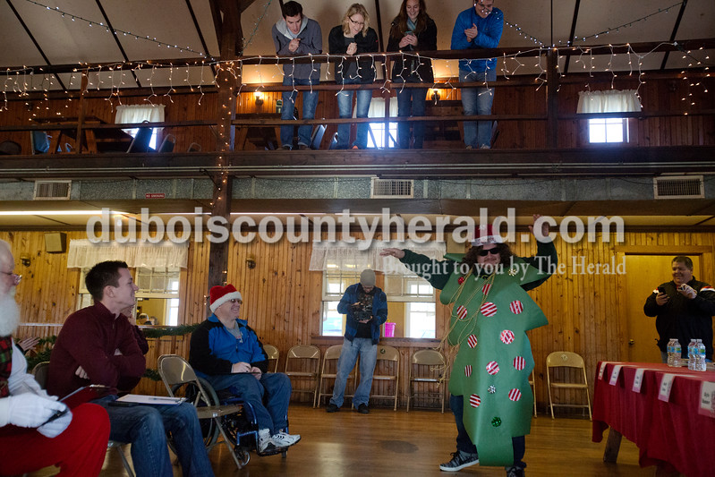 Erica Lafser/The Herald<br /> Sam Stites of Jasper danced across the room for his entrance to the Fruitcake eating championship at the American Legion Post #242 in Santa Claus on Saturday. Stites won Best Attire and came in strong with a 5th place finish and a time of 6:48.