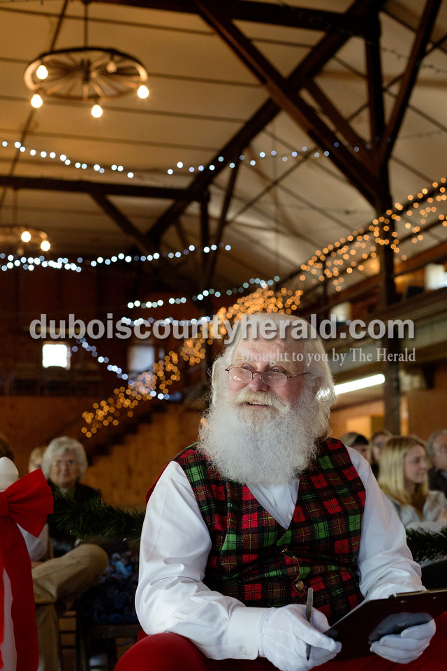 Erica Lafser/The Herald<br /> Santa Claus helped judge the Fruitcake eating championship at the American Legion Post #242 in Santa Claus on Saturday.