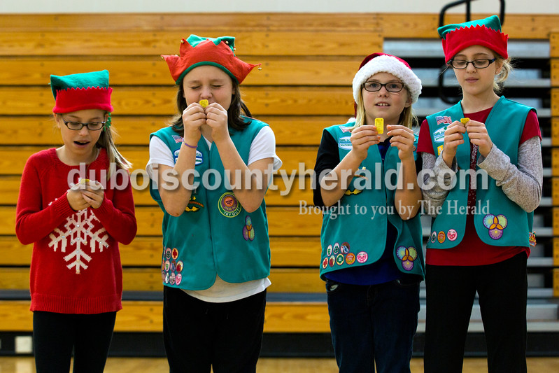 Alisha Jucevic/The Herald<br /> Ireland junior Girl Scout troop 357 members, Taylor Buechlein, 10, Karleigh Lemond, 10, left, Taryn Schmitt, 10, and Brianna Williams, 11, all of Jasper,  checked their raffle ticket numbers, hoping to get a photograph with Santa, during the 78th American Legion Post 147's annual community Christmas party at Jasper Middle School on Saturday afternoon. Throughout the weekend Post 147 brings Santa Claus to visit five different nursing homes around the community.