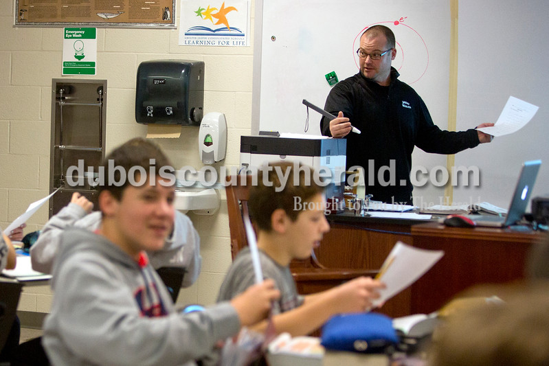 Ariana van den Akker/The Herald<br /> Jasper Middle School science teacher Matt Pryor taught a lesson in his classroom on Wednesday. Every year on the day before Thanksgiving break, Pryor speaks to his students about his life story and the lessons learned from it.