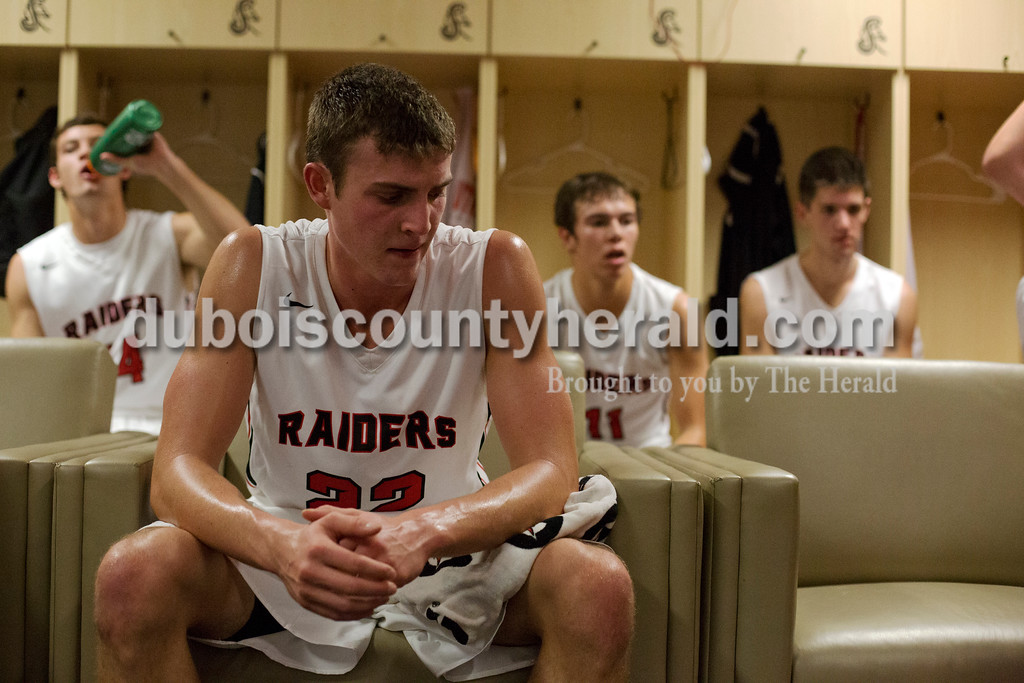 Erica Lafser/The Herald<br /> Southridge's Jayden Montgomery rested in the locker room during halftime of Saturday night's game against Corydon Central at Memorial Gym in Huntingburg. The Raiders won 54-39.