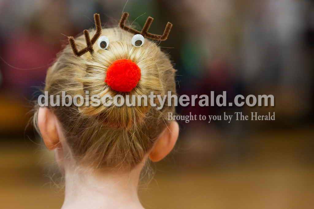 Alisha Jucevic/The Herald<br /> Brailyn Whaley of Jasper, 10, sported a reindeer hairstyle during the 78th American Legion Post 147's annual community Christmas party at Jasper Middle School on Saturday afternoon. She said her mother found the reindeer kit at a store and helped her style it for the event.