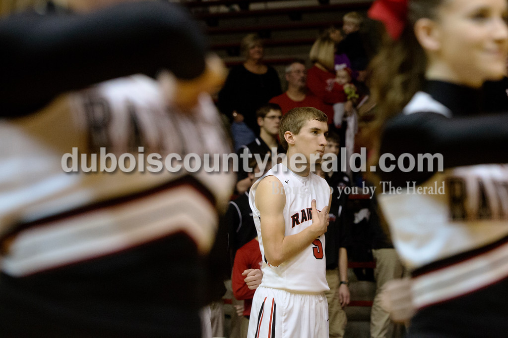 Erica Lafser/The Herald<br /> Southridge's Gaage Fetter held his hand over his heart for the playing of the national anthem before Saturday night's game against Corydon Central at Memorial Gym in Huntingburg. The Raiders won 54-39.