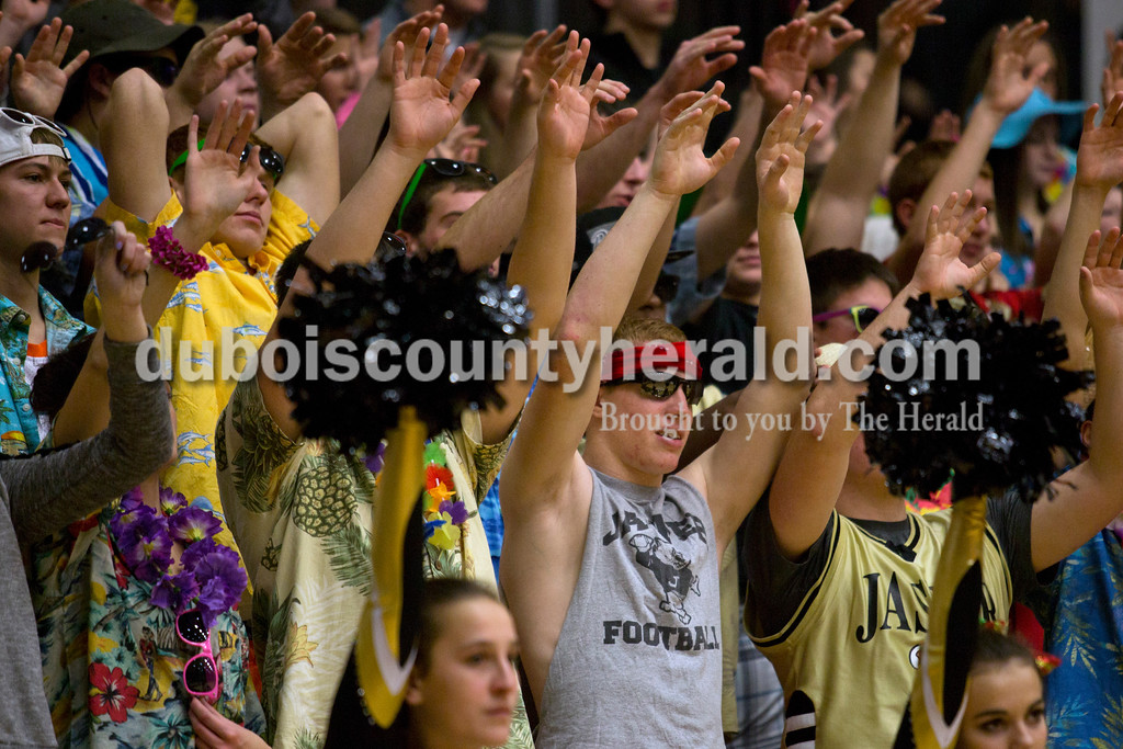 Jasper senior Tate Blessinger and the Wildcat student section held up their hands for good luck as the Wildcats shot a free throw during Saturday night's basketball game against Mount Carmel in Jasper. The Wildcats won 62-37. <br /> Alisha Jucevic/The Herald