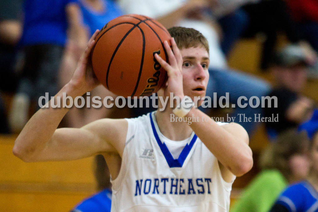 Alisha Jucevic/The Herald<br /> Northeast Dubois' Drew Jacob looked to pass during Saturday night's game against Tecumseh in Dubois. The Jeeps won 53-46.