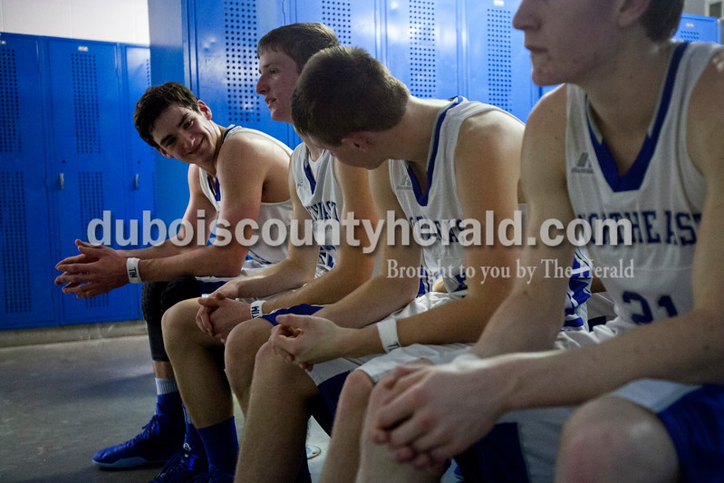 Alisha Jucevic/The Herald<br /> Northeast Dubois' Keigan Meyer talked with teammates Drew Jacob and Kaden Quinn as they waited for coach Terry Friedman during halftime of Saturday night's game against Tecumseh in Dubois. The Jeeps won 53-46.