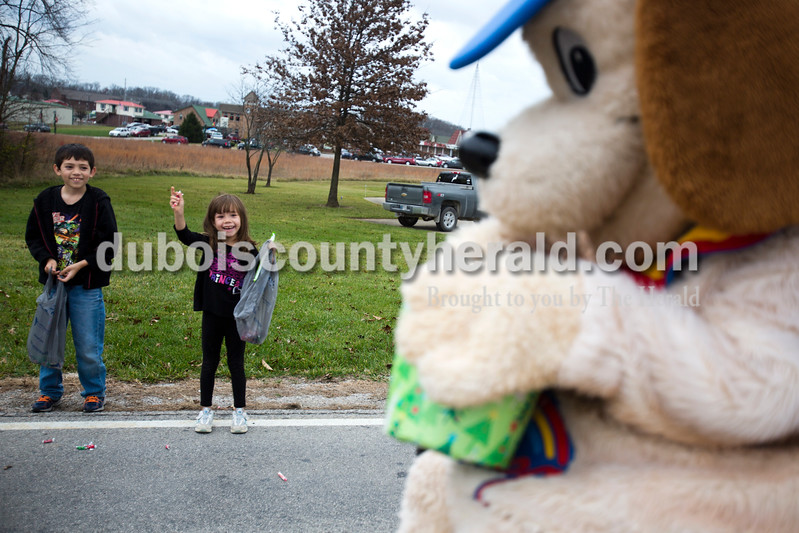 Nicolas Sandoval, 8, and Olivia Sandoval, 5, both of Dale, collected candy during Santa Claus' annual Christmas parade on Saturday afternoon. The town continued their festive celebrations over the weekend with chestnut roasting, the Santa Claus Land of Lights, the Das Nikolaus Fest, visiting with an Elf on the North Pole Network and much more. <br /> Alisha Jucevic/The Herald