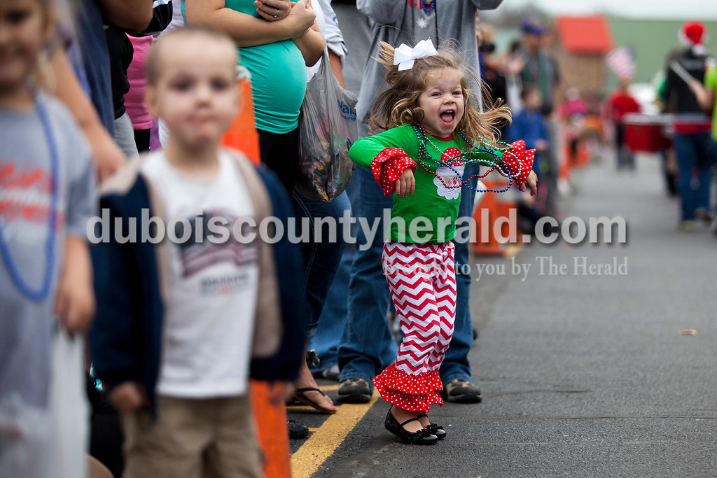 Kynlee Stephens of Santa Claus, 3, jumped in excitement as she saw Santa Claus and his reindeer in Santa Claus' annual Christmas parade on Saturday afternoon. The town continued their festive celebrations over the weekend with chestnut roasting, the Santa Claus Land of Lights, the Das Nikolaus Fest, visiting with an Elf on the North Pole Network and much more. <br /> Alisha Jucevic/The Herald