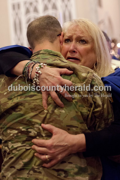 """Erica Lafser/The Herald<br /> Melanie Ferber of Holland hugged her grandson, Huntingburg native Austin Reutepohler, while she and her husband Walt were surprised with his visit to St. James Lutheran Church in Holland on Sunday. Reutepohler was recently deployed as a combat engineer in the Army to Kuwait for eight months, but despite him being back in the states since October, this was the Ferber's first time seeing him in the past year. He has been stationed in Fort Carson, Colorado since being back from Kuwait. """"Every emotion came within three seconds... It's the best Christmas present I could have,"""" Melanie said."""