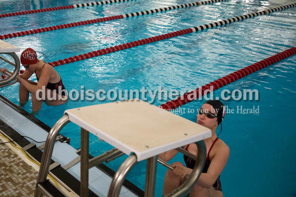 Erica Lafser/The Herald<br /> Heritage Hills' Erica Schmidt, left, and Southridge's Jade Jochem took their starting positions for the girls 200-yard medley relay during Monday night's meet in Huntingburg.
