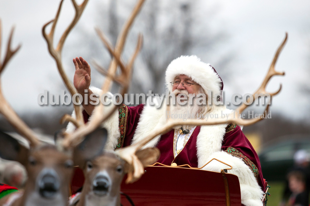 Santa Claus waved to parade onlookers during Santa Claus' annual Christmas parade in downtown on Saturday afternoon. The town continued their festive celebrations over the weekend with chestnut roasting, the Santa Claus Land of Lights, the Das Nikolaus Fest, visiting with an Elf on the North Pole Network and much more. <br /> Alisha Jucevic/The Herald
