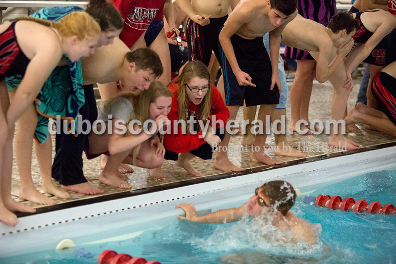 Erica Lafser/The Herald<br /> Heritage Hills swim team members cheered on their teammate, Austin Schnuck, in the boys 100-yard breaststroke race during Monday night's meet against Southridge in Huntingburg.
