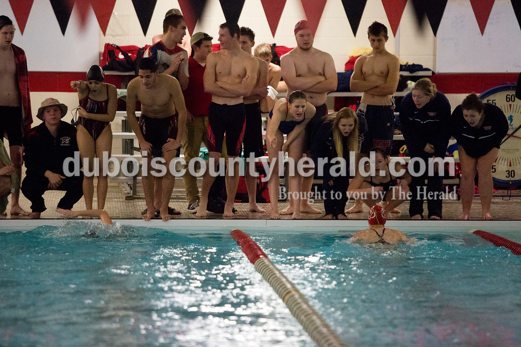 Erica Lafser/The Herald<br /> Teammates lined the end of the pool to cheer for Southridge's Ellie Langebrake, left, and Heritage Hills' Samantha Skelton during Monday night's meet in Huntingburg.
