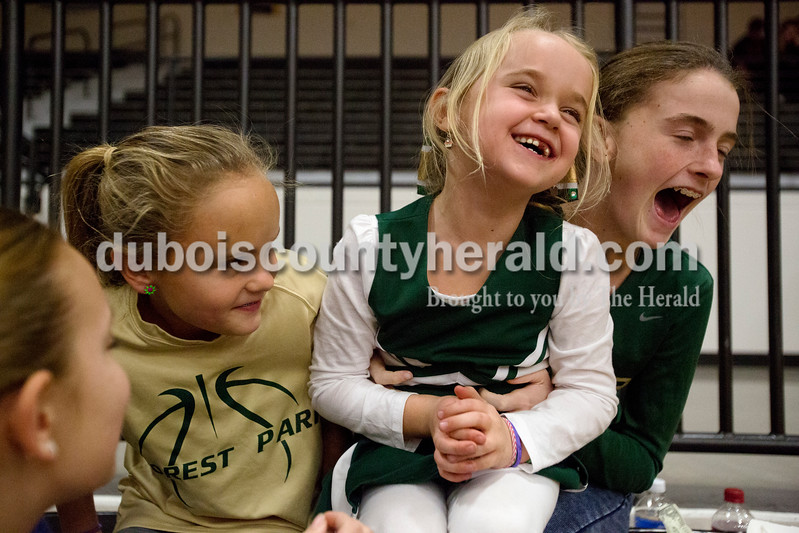 Erica Lafser/The Herald<br /> Layni Litherland of Troy, 6, was tickled by Molly Lusk of Ferdinand, 13, right, while Layni's sister Mayci, 9, sat by during Saturday night's Dubois County Hoops Classic consolation game between Forest Park and Southridge in Jasper. The Litherland girls are Forest Park's head coach's daughters. The Rangers won 57-48.
