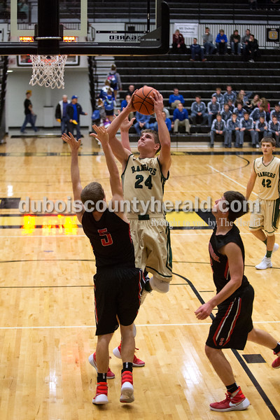 Erica Lafser/The Herald<br /> Forest Park's Ben Wendholt went up for a shot against Southridge's Gaage Fetter during Saturday night's Dubois County Hoops Classic consolation game in Jasper. The Rangers won 57-48.