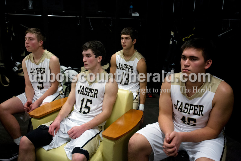 Erica Lafser/The Herald<br /> Jasper's Adam Hedinger, Tyler Nottingham, Elliot Prange, and Johnny Bounds sat in the locker room at halftime of Saturday night's Dubois County Hoops Classic championship game against Northeast Dubois in Jasper. The Wildcats won 60-31.
