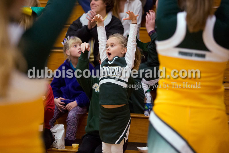 "Erica Lafser/The Herald<br /> Layni Litherland of Troy, 6, cheered along with the Forest Park cheerleaders during Monday night's game between Forest Park and Boonville at South Spencer County High School in Rockport. The Rangers won 69-62. ""I wanna be a Ranger cheerleader when I grow up,"" Litherland said."
