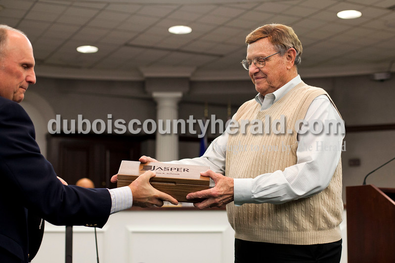 Alisha Jucevic/The Herald<br /> Jasper mayor Terry Seitz presented councilman Tom Schmidt, and the other councilmen ending their terms, with tokens of appreciation during Tuesday night's Jasper Common Council at City Hall in Jasper. After forty years of service, Tom Schmidt, is retiring from his position on the council.