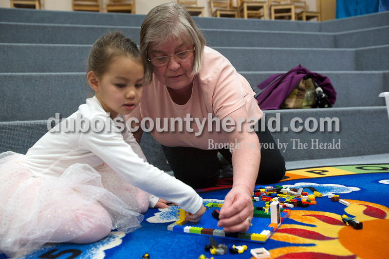 "Erica Lafser/The Herald<br /> Isabel Goeppner of Dublin, Ohio, 4, attended the Jasper Public Library's Lego Club on Sunday with her grandmother Rose Goeppner of Jasper. ""Isabel loves legos,"" Rose said. ""She got legos for Christmas."" Rose thought it was a good idea to bring Isabel since she loved legos and she was in town visiting. The two worked together to make a rainbow playground with the seemingly unlimited supply of legos they had, since they were the only two in attendance — aside from Assistant Librarian Venita Lucchi of Jasper, who subbed for the normal host, Lisa McWilliams."