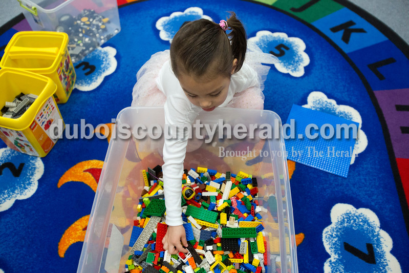 "Erica Lafser/The Herald<br /> Isabel Goeppner of Dublin, Ohio, 4, reached into a bin of legos, looking for people to put on the playground her and her grandmother, Rose Goeppner of Jasper, were building during the Jasper Public Library's Lego Club on Sunday at the Jasper Public Library in Jasper. ""Isabel loves legos,"" Rose said. ""She got legos for Christmas."" Rose thought it was a good idea to bring Isabel since she loved legos and she was in town visiting. The two worked together to make a rainbow playground with the seemingly unlimited supply of legos they had, since they were the only two in attendance — aside from Assistant Librarian Venita Lucchi of Jasper, who subbed for the normal host, Lisa McWilliams."