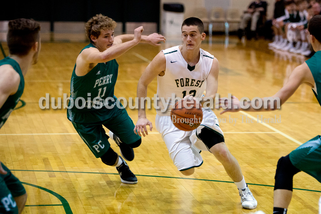 Forest Park's David Lusk ran up the court with Perry Central's Luke Hubert in pursuit during Monday night's game in Ferdinand. The Rangers won 58-37. Ariana van den Akker/The Herald