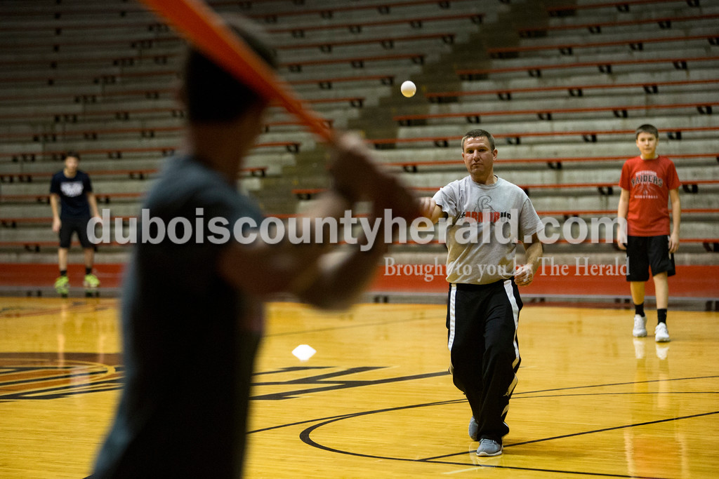Southridge head coach Ted O'Brien delivered a pitch during the whiffle ball game on New Year's Eve at Huntingburg Memorial Gymnasium. Dave Weatherwax/The Herald