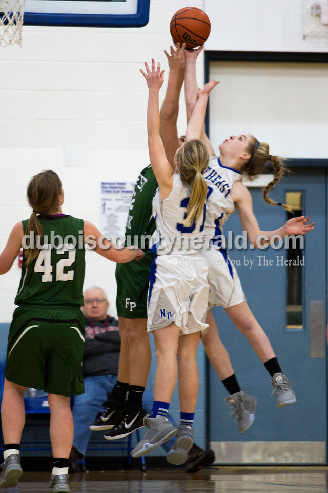 Alisha Jucevic/The Herald<br /> Northeast Dubois' Kortney Quinn and Clare Mangin fought for a rebound against Forest Park's Karissa Wollenmann during Tuesday night's game in Dubois. Forest Park won 55-50 in overtime.