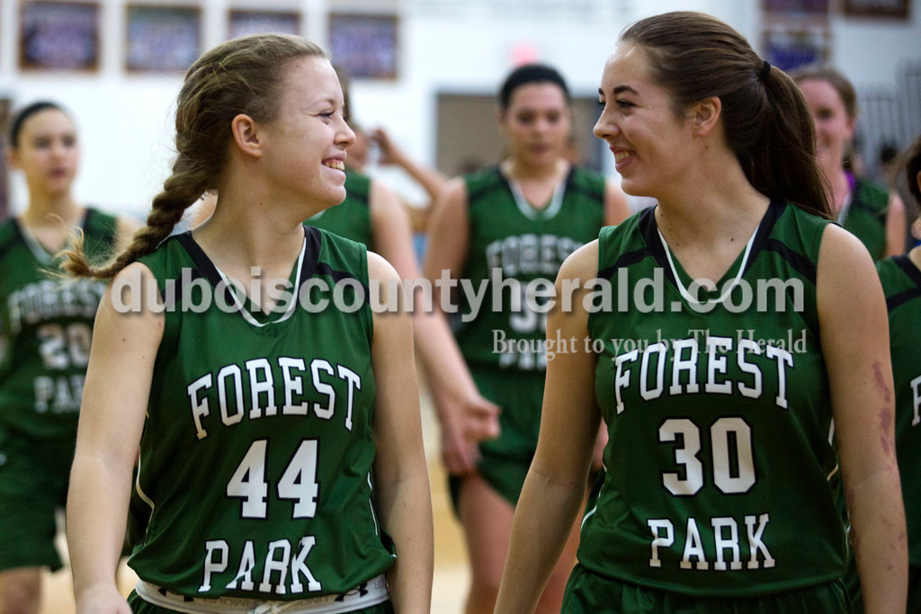 Alisha Jucevic/The Herald<br /> Forest Park's Emma Uebelhor and Avie Gould walked off the court with their team after Forest Park defeated Northeast Dubois 55-50 in overtime at Tuesday night's game in Dubois.