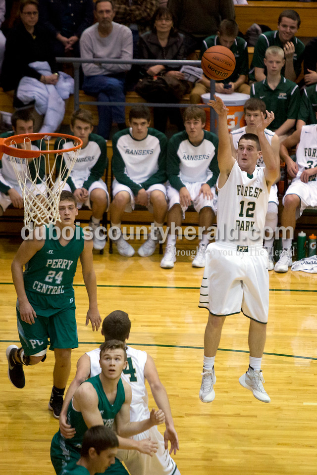 Forest Park's David Lusk launched the ball during Monday night's game against Perry Central in Ferdinand. The Rangers won 58-37. Ariana van den Akker/The Herald