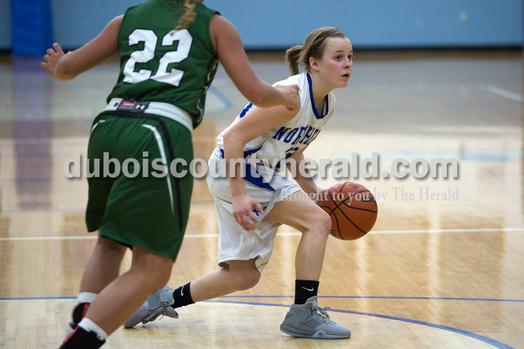 Alisha Jucevic/The Herald<br /> Northeast Dubois' Jessica Kahle looked to pass as Forest Park's Mariah Morgan rushed forward to defend during Tuesday night's game  in Dubois. Forest Park won 55-50 in overtime.