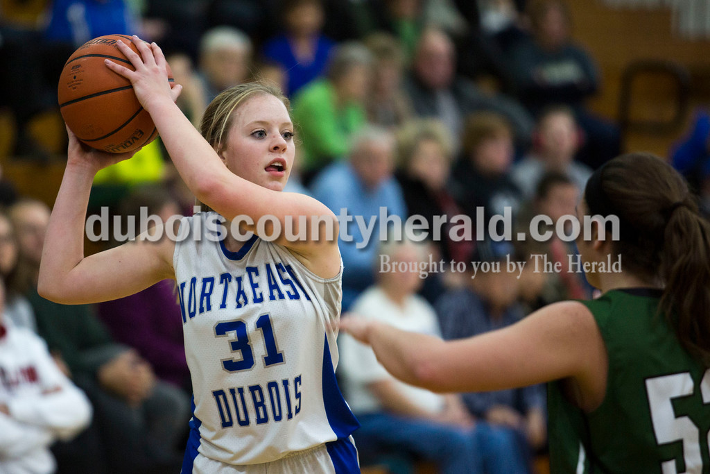 Alisha Jucevic/The Herald<br /> Northeast Dubois' Kortney Quinn looked to pass during Tuesday night's game against Forest Park in Dubois. Forest Park won 55-50 in overtime.