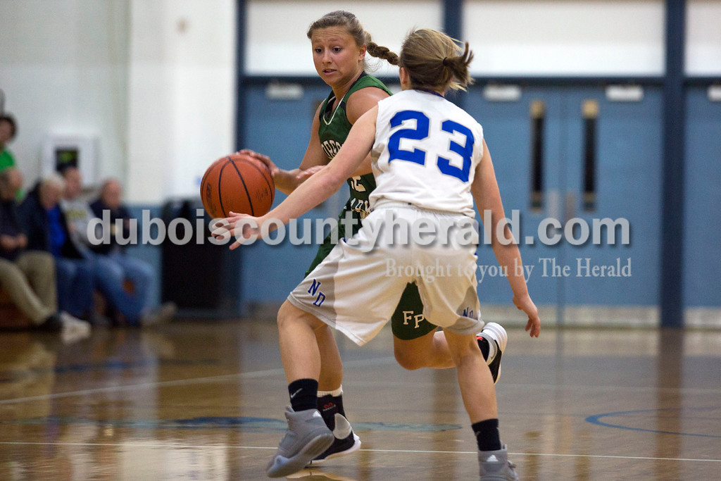 Alisha Jucevic/The Herald<br /> Forest Park's Mariah Morgan drove the ball past Northeast Dubois' Jessica Kahle during Tuesday night's game in Dubois. Forest Park won 55-50 in overtime.