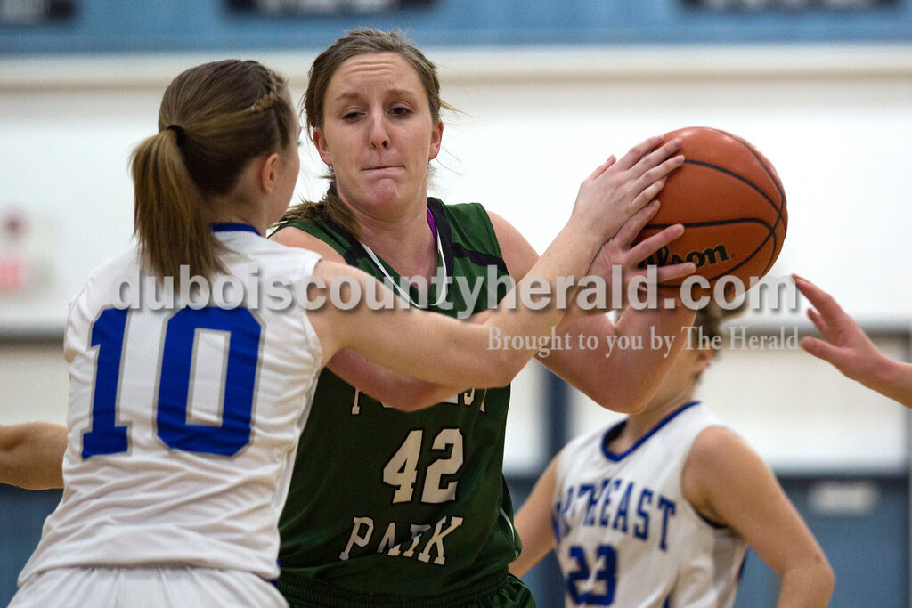Alisha Jucevic/The Herald<br /> Northeast Dubois' Adison Denu fought for the ball against Forest  Park's Rachel Hopf during Tuesday night's game in Dubois. Forest Park won 55-50 in overtime.